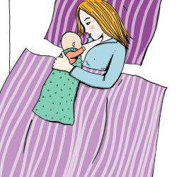 Stillende mit Baby im Bett