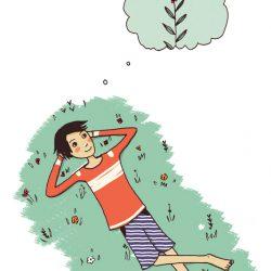 Junge liegt auf Wiese und denkt an Blumen
